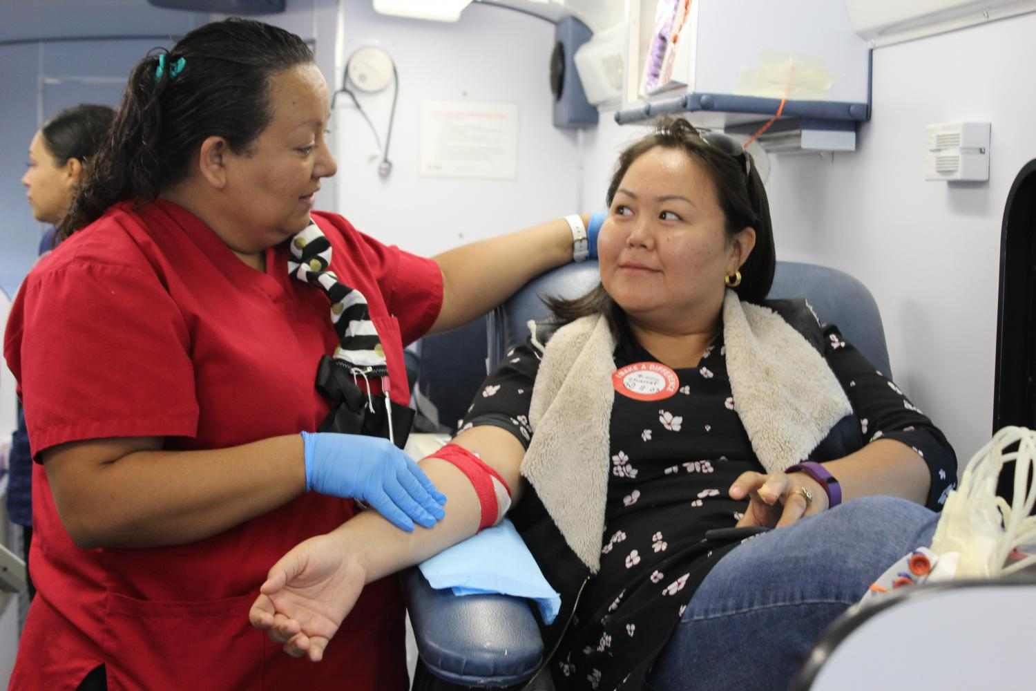 Supervisor/ Charge nurse Veronica Sereno with patient Zhanat Alipova. After each donor gave blood, the student received free complimentary snacks to insure that the donors do not become lightheaded from the donation. Photo credit: Scarled Murillo