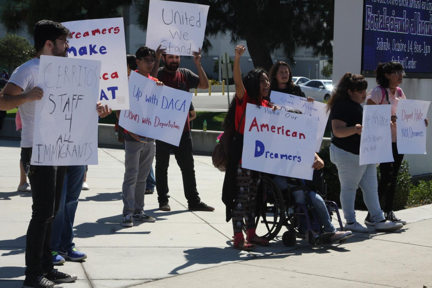 Cerritos College students came out to stand and make thier voices heard afther the DACA Town Hall meeting. They stood on the corner of Alondra and Studebaker. Photo credit: David Jenkins