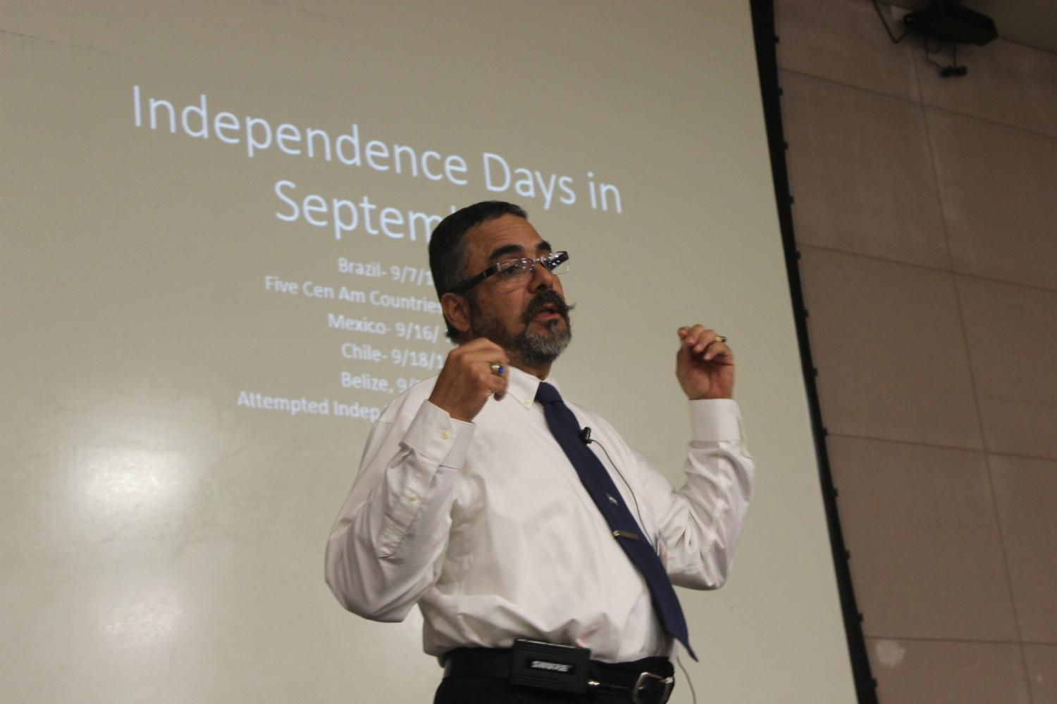 Professor Walter Fernandez begins his lecture on 'Independence Days in September'  and gives students a quick overview of what he will be covering. Puerto Rico will celebrate their attempted independence on September 23rd. Photo credit: Alison Hernandez