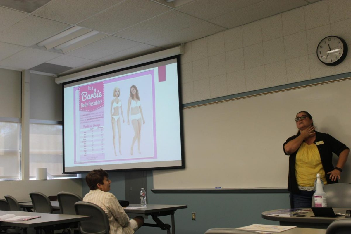 Pamela Sepulveda, social worker and community outreach program director teaching students about body image. She compared the difference between and real life woman and a barbie and said the head is bigger than a normal human being, the neck is too long, and the waist is too small, which she described as
