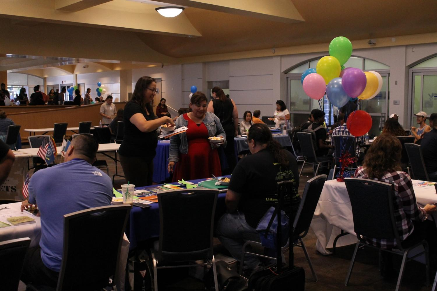 Students were collecting information from the holistic event. Resources were made available to those in the LGBTQ+ community, undocumented students, victims of domestic violence, those addicted to substances and those with mental health issues. Photo credit: Jose Flores