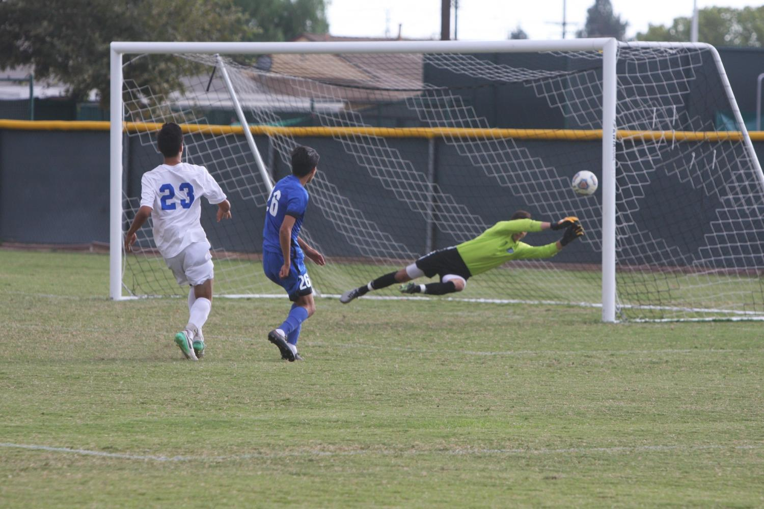 Brian Rodriguez shoots and hits the post. The Falcons look to amplify their unbeaten streak and get their seventh shutout game when they visit Taft college on Tuesday Sept. 19. Photo credit: David Jenkins