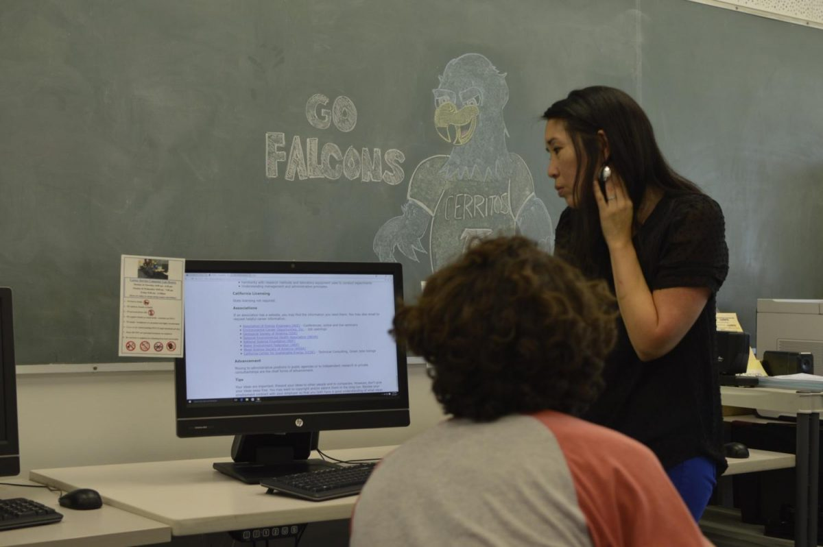 Counselor Traci Ukita shows students the Eureka website in order to gain more insight on their desired career choice. Networking plays a key role in informational interviews. Photo credit: Carlos Martinez