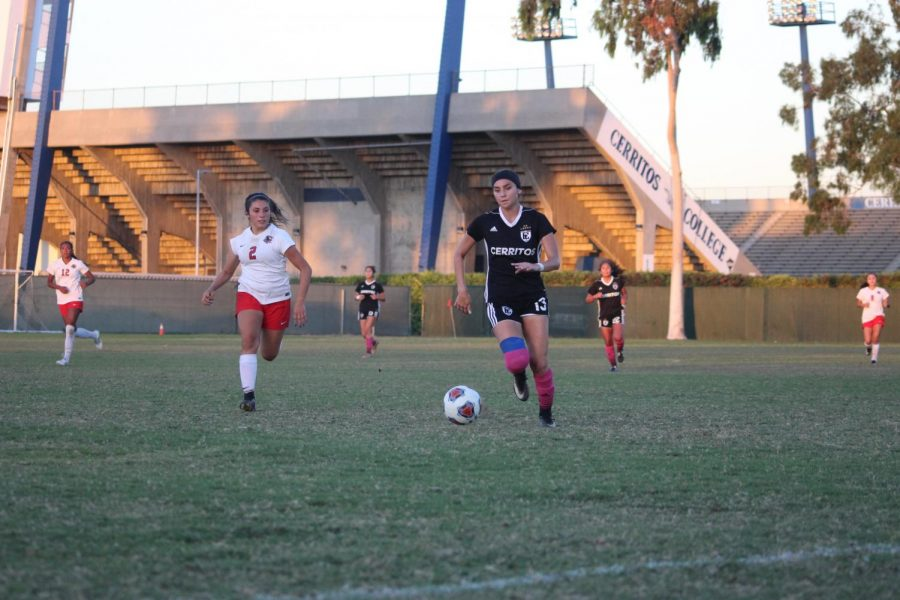 Mid-field player No.13 Stephanie Nava running with the ball trying to head near the opponents goal. The Cerritos College Falcons will travel to Pasadena City College on Friday at 4 p.m. for a crossover game. Photo credit: Scarled Murillo