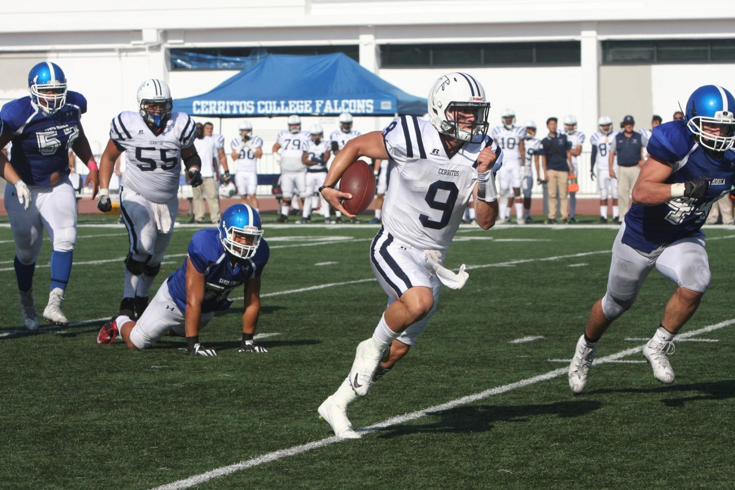 No. 9 quarterback Quentin Davis passing the line of scrimmage to run onto Santa Monica territory. Photo credit: David Jenkins