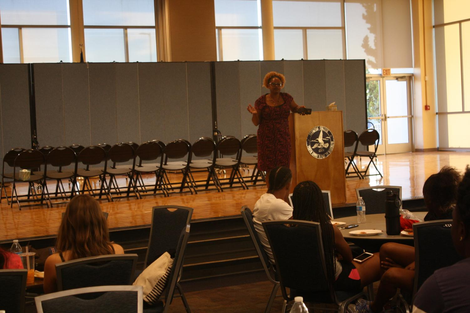 Director of Diversity, Compliance, and Title IX Coordinator Valyncia Raphael, informed students about Domestic Violence Awareness Month. She opened up an open-mic session. Photo credit: Rocio Valdez