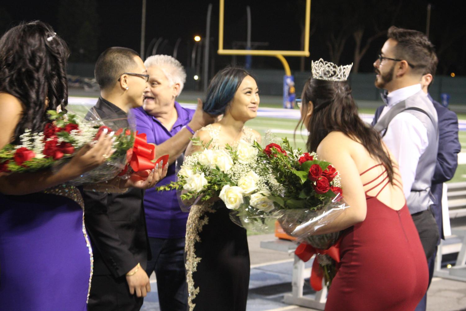 Jazmine Jose is crowned 2017 Homecoming Queen. The 2016 homecoming queen, Megan Kim, was invited back to be a part of the event. Photo credit: David Jenkins