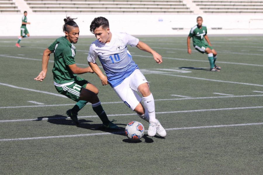 Mid-Field player No.10 Luis Garcia with possession of the ball against ELAC opponent. The game was full of aggression but the Falcon's kept their cool and played with strategy. Photo credit: Scarled Murillo