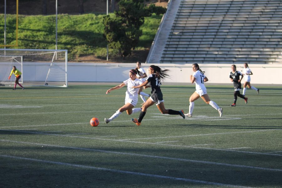 Player No.2 Sophie Saouma fighting for possession of the ball against ELAC opponent. Photo credit: Scarled Murillo
