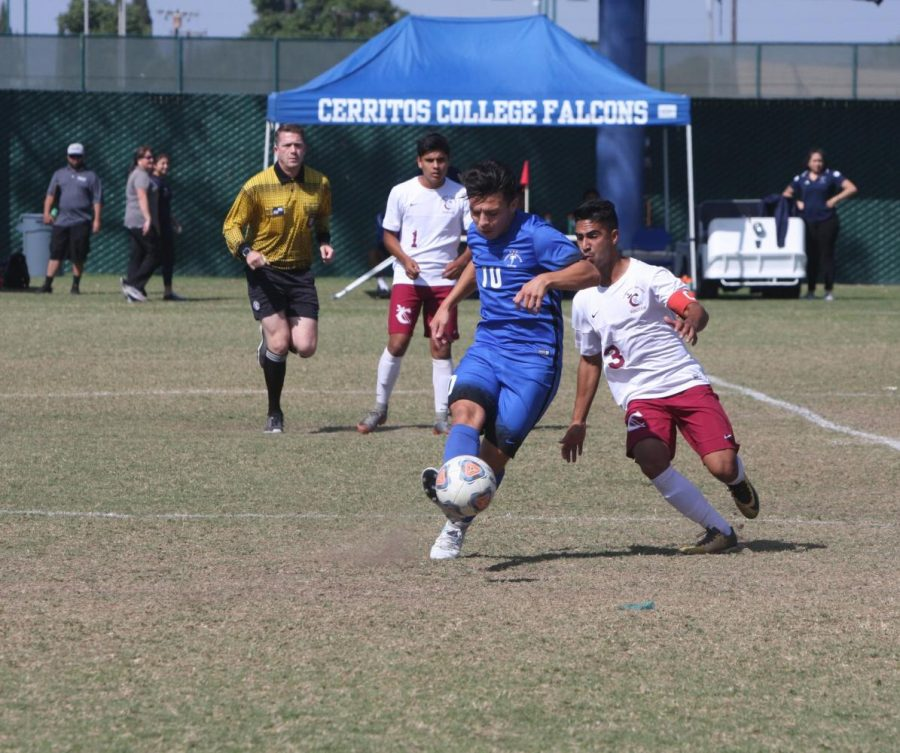 Falcons' No. 10 midfielder Luis Garcia attempts to pass the ball in an assist.  The Falcons won the game agaist compton 4-1. Photo credit: David Jenkins