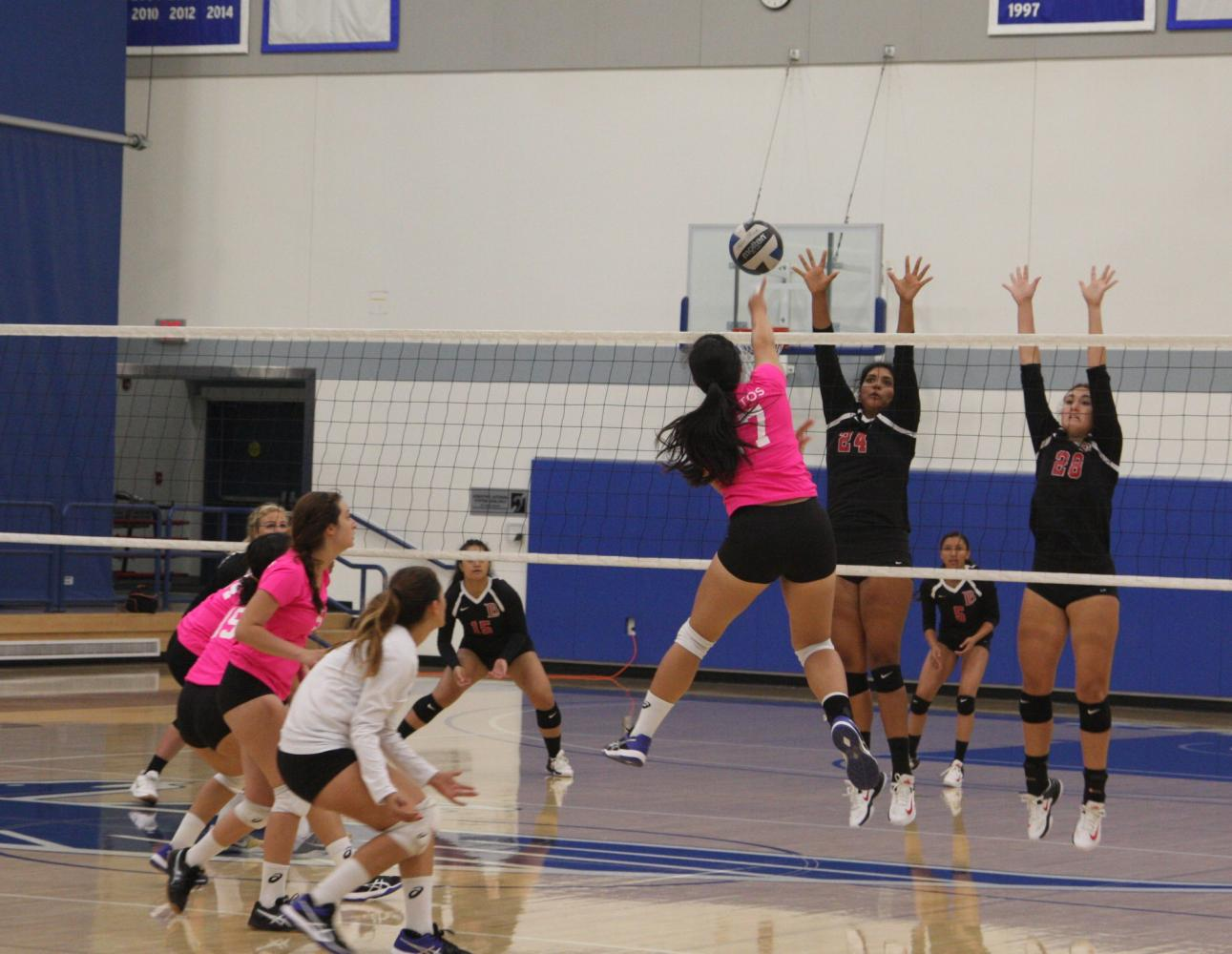 Falcons' No. 17 Jody Suski spiking the ball against Long Beach. The Falcons lost 3-0. Photo credit: David Jenkins
