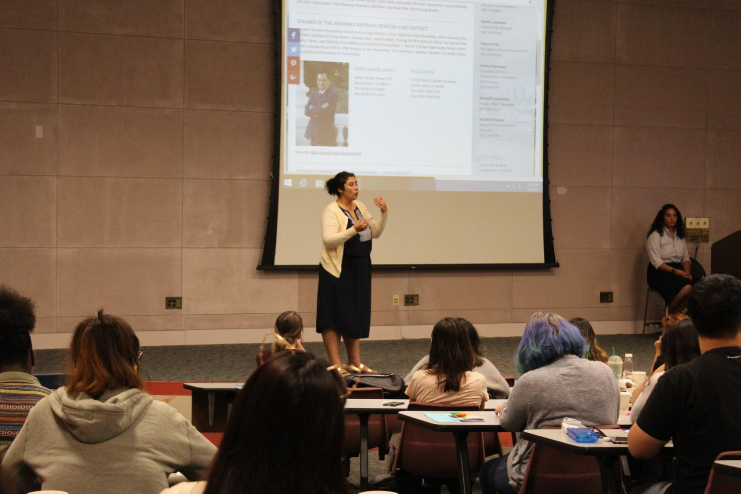 Guest speaker, Helena Youssef, at the Women, Work and Civic Duty presentation organized by the Women and Gender Studies Department Chair Ana Torres-Bower and Mariam Youssef, adjunct professor. Helena Youssef explains the importance of knowledge, respect and understanding to be successful in achieving political goals. Photo credit: Carmelita Islas Mendez