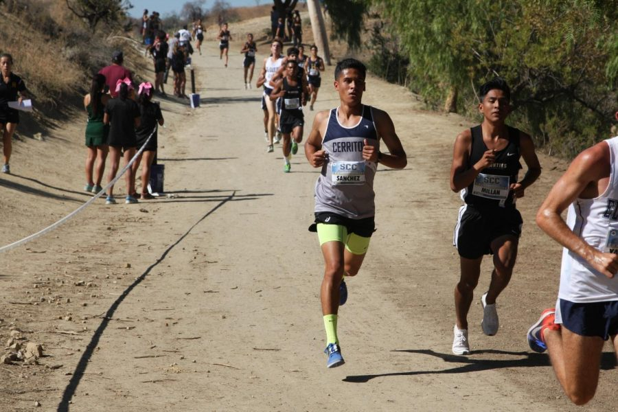 Falcons+Abraxaz+Sanchez+coming+down+hill+at+the+end+of+the+course+at+Mt.SAC.+Sanchez+came+in+sixth+place+overall.+Photo+credit%3A+David+Jenkins