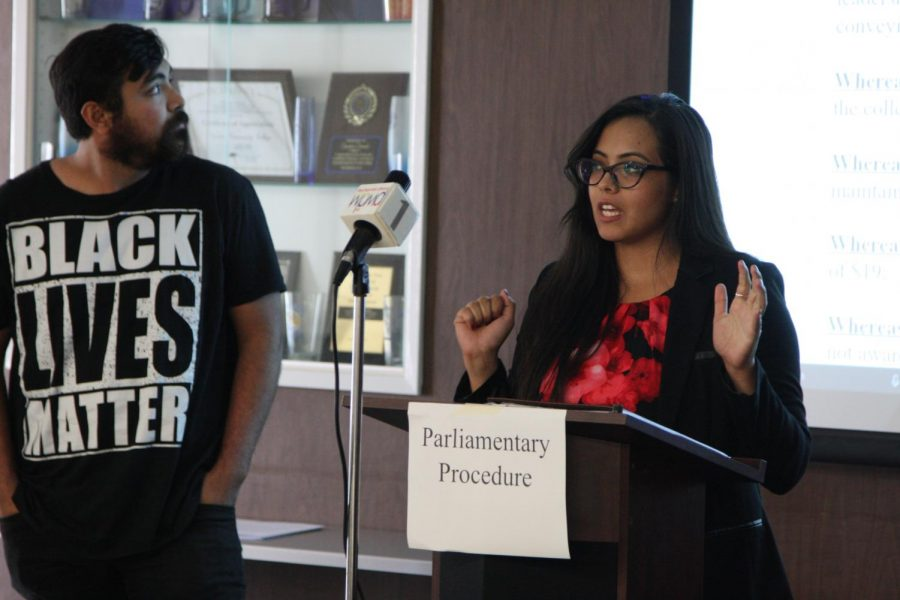 Sociology+major+Carina+Rodriguez+speaking+to+ASCC+senate%2C+alongside+her%2C+Luis+Guzman+history+major.+They+spoke+on+bringing+awareness+to+students+about+resources.+Photo+credit%3A+David+Jenkins