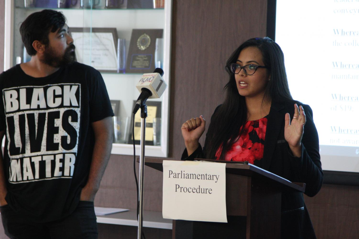 Sociology major Carina Rodriguez speaking to ASCC senate, alongside her, Luis Guzman history major. They spoke on bringing awareness to students about resources. Photo credit: David Jenkins
