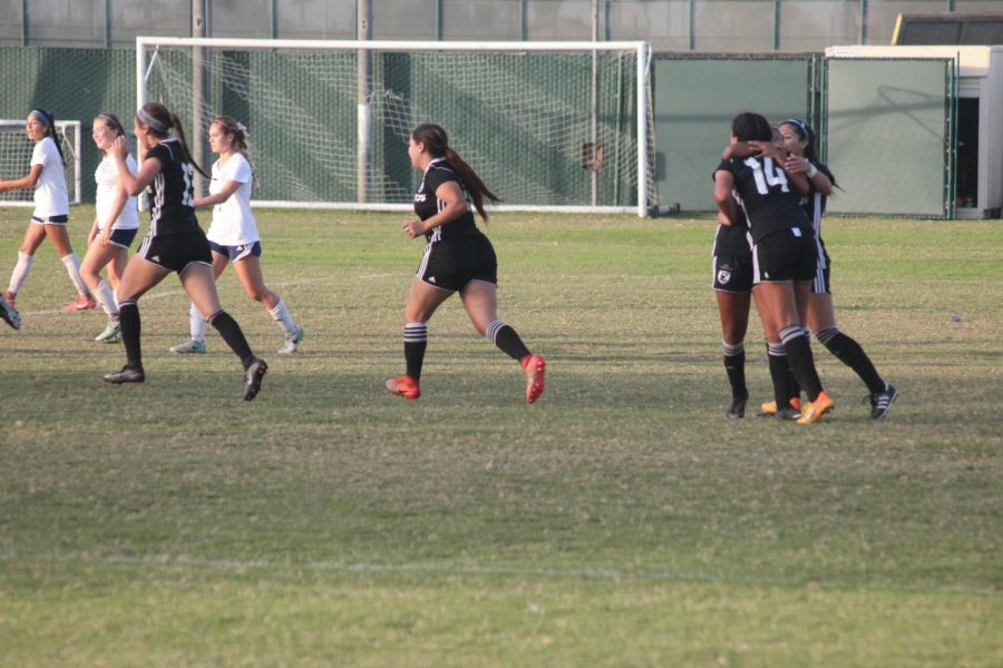 No. 9 Itzel Balesteros hugs No. 14 Jackie Beristain after Beristain scored a goal to tie the game. Falcons won 2-1. Photo credit: Jah-Tosh Baruti