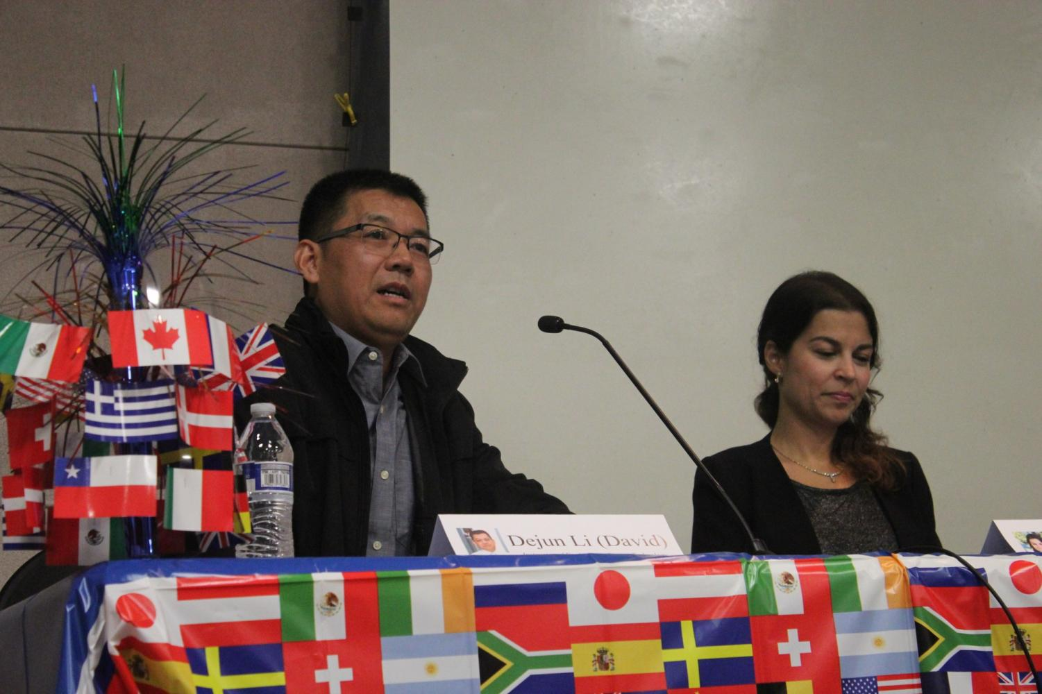 Dejun (David) Li, engineering design technology instructor, and Paula Pereira, instructor and librarian, answer student questions in a panel. Educators share their experiences as international students that led them to their careers. Photo credit: Carlos Martinez