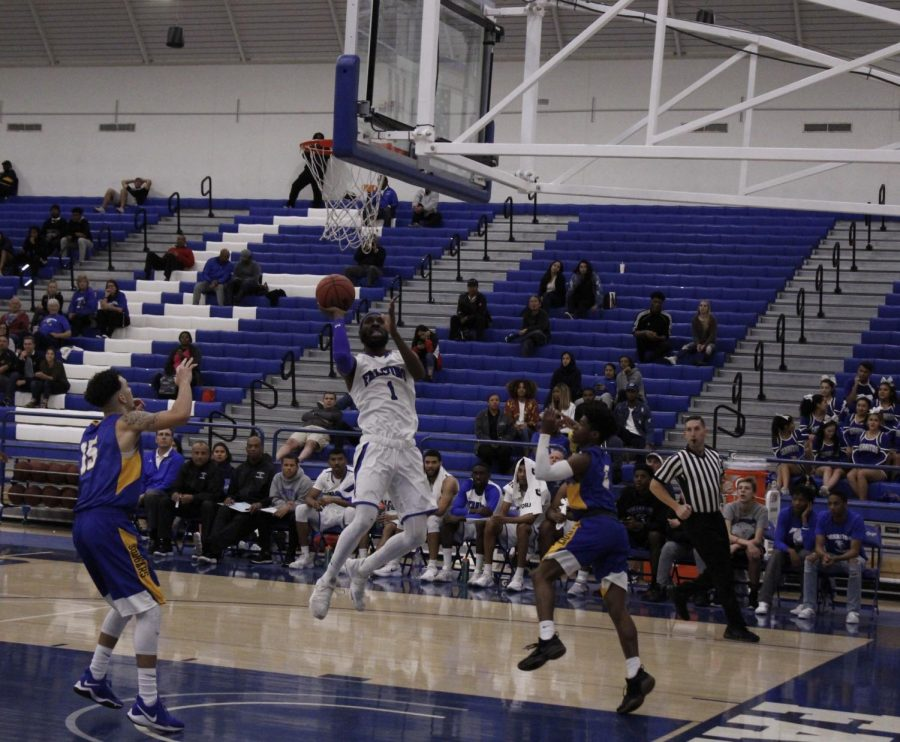 No. 1 Demetrius Thomas shoots close to the rim. He finished with 21 points to lead Cerritos.