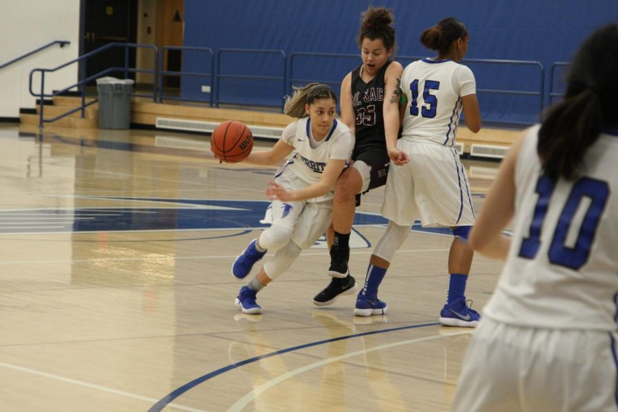 No. 2 Angie Ferreira drives the ball against a Mt. SAC defender. She finished the game 8-8 from the FT line.