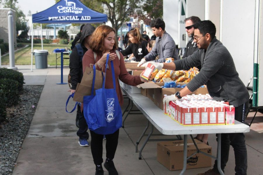 Psychology major, Diana Salazar taking part of the Los Angeles Regional Food Bank that took place Tuesday. She was one of the 350 students that was handed a