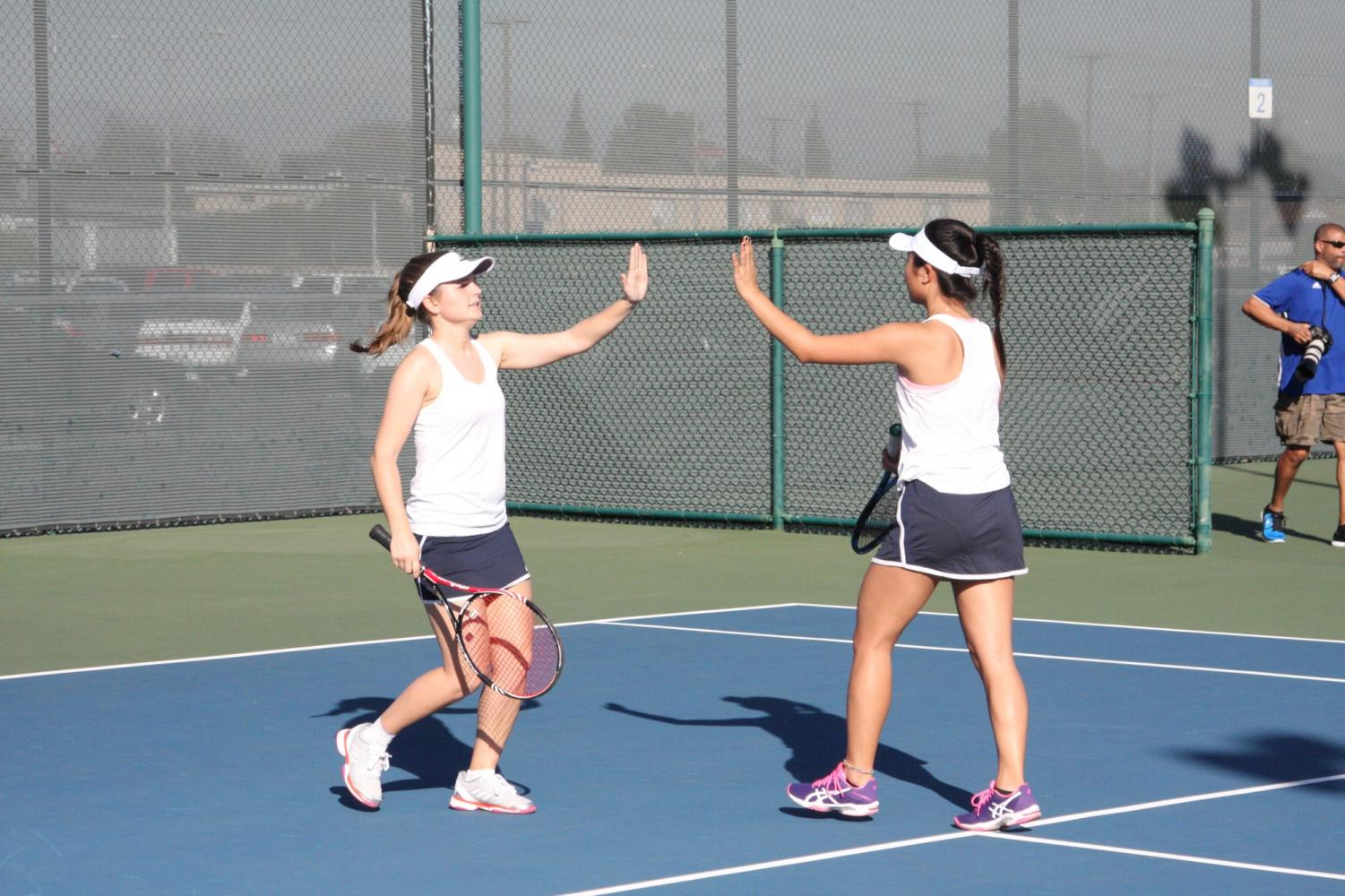 Lisa Suzuki and Petra such celebrate winning the doubles match. Suzuki and Such played against Hope International University's Jessica Cornea and Jovana Milosevic.