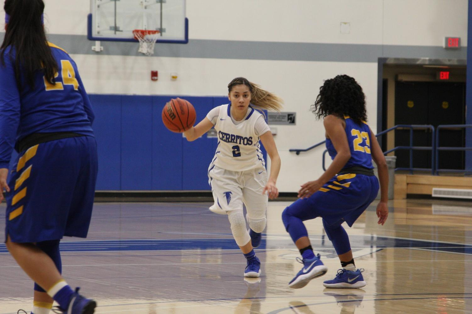 Sophomore, Angie Ferreira No. 2 dribbles past the defending point guard. Ferreira dished out 3 assists.