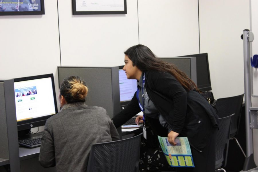 Kimberly Munoz, federal work-study student, helping Yoong Park, art major, with their FAFSA application. The Financial Aid Resource Center offer assistance to those who need guidance in completing their application.