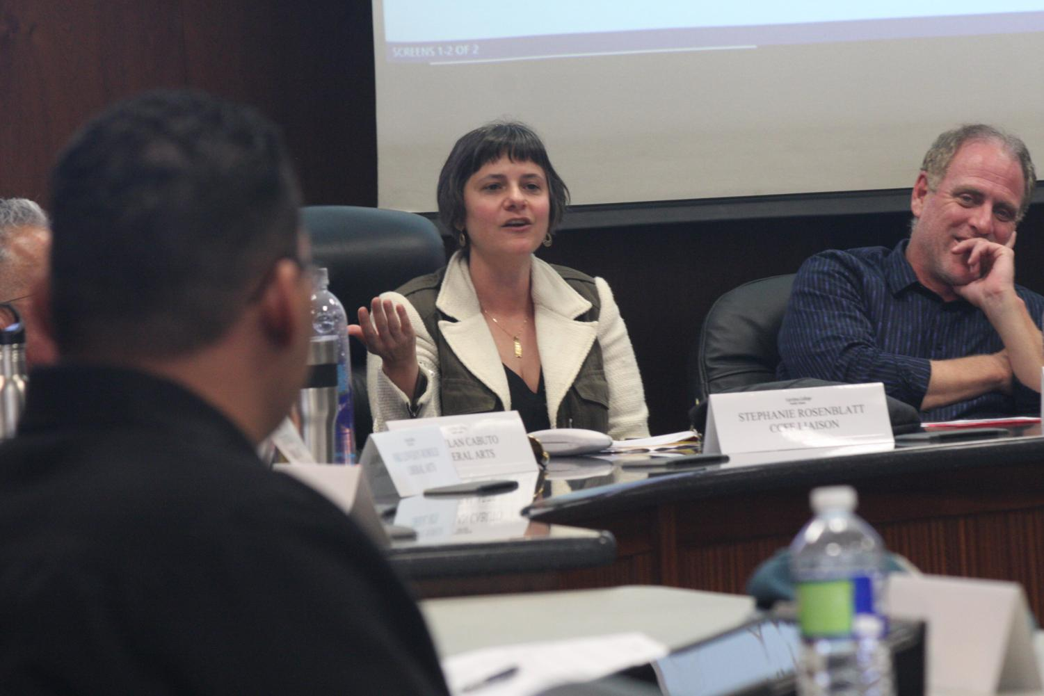 While in Faculty Senate Stephanie Rosenblatt, Cerritos College Faculty Federation liaison, asks other members to attend the Board of Trustees meeting. Rosenblatt hopes to have 40 other faculty members attend the meeting to support part-time counselors.