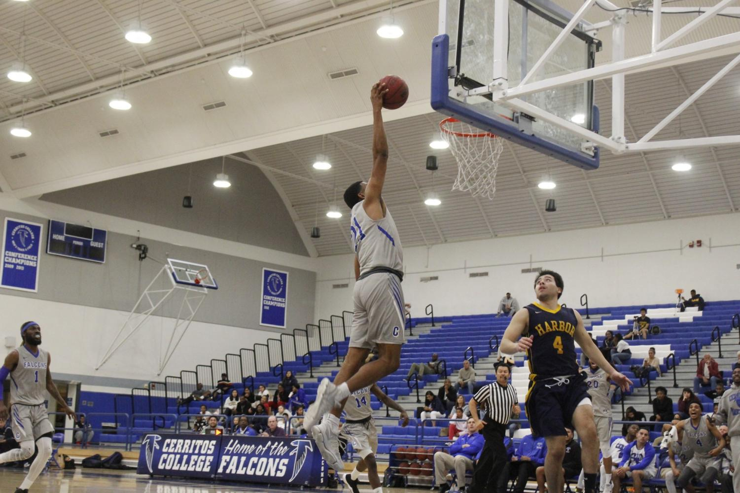No. 21 Johnathon Guzman goes up for the fast break dunk. Guzman finished the game.
