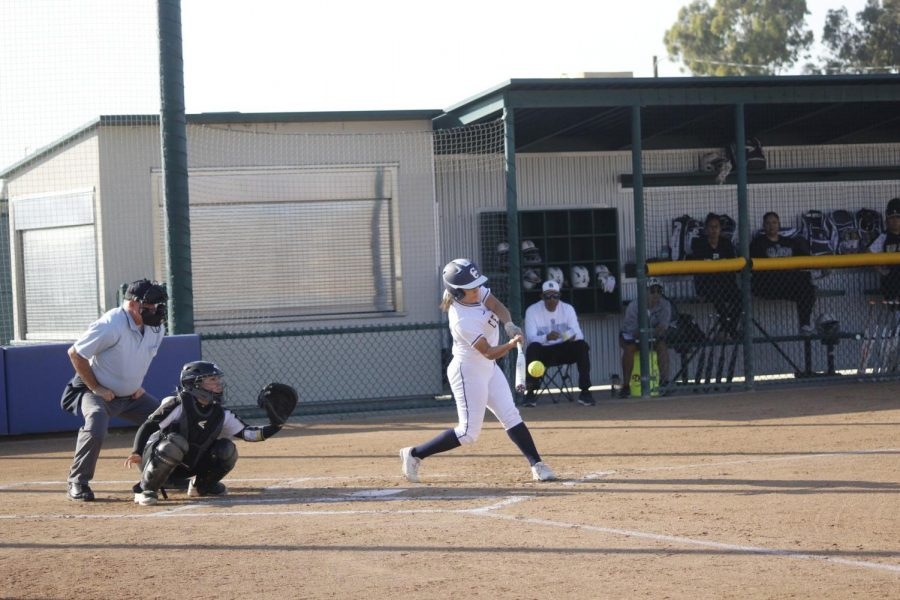 Freshman+third+baseman+No.+12++Deja+Sendejas+about+to+smack+the+ball.+She+had+one+RBI+and+one+BB+in+the+game.