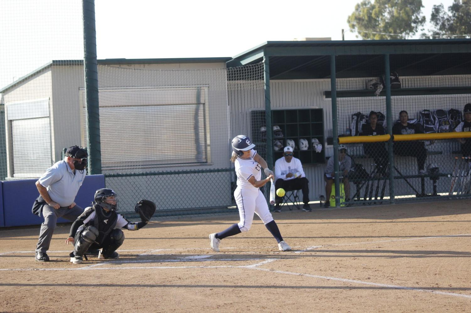 Freshman third baseman No. 12  Deja Sendejas about to smack the ball. She had one RBI and one BB in the game.