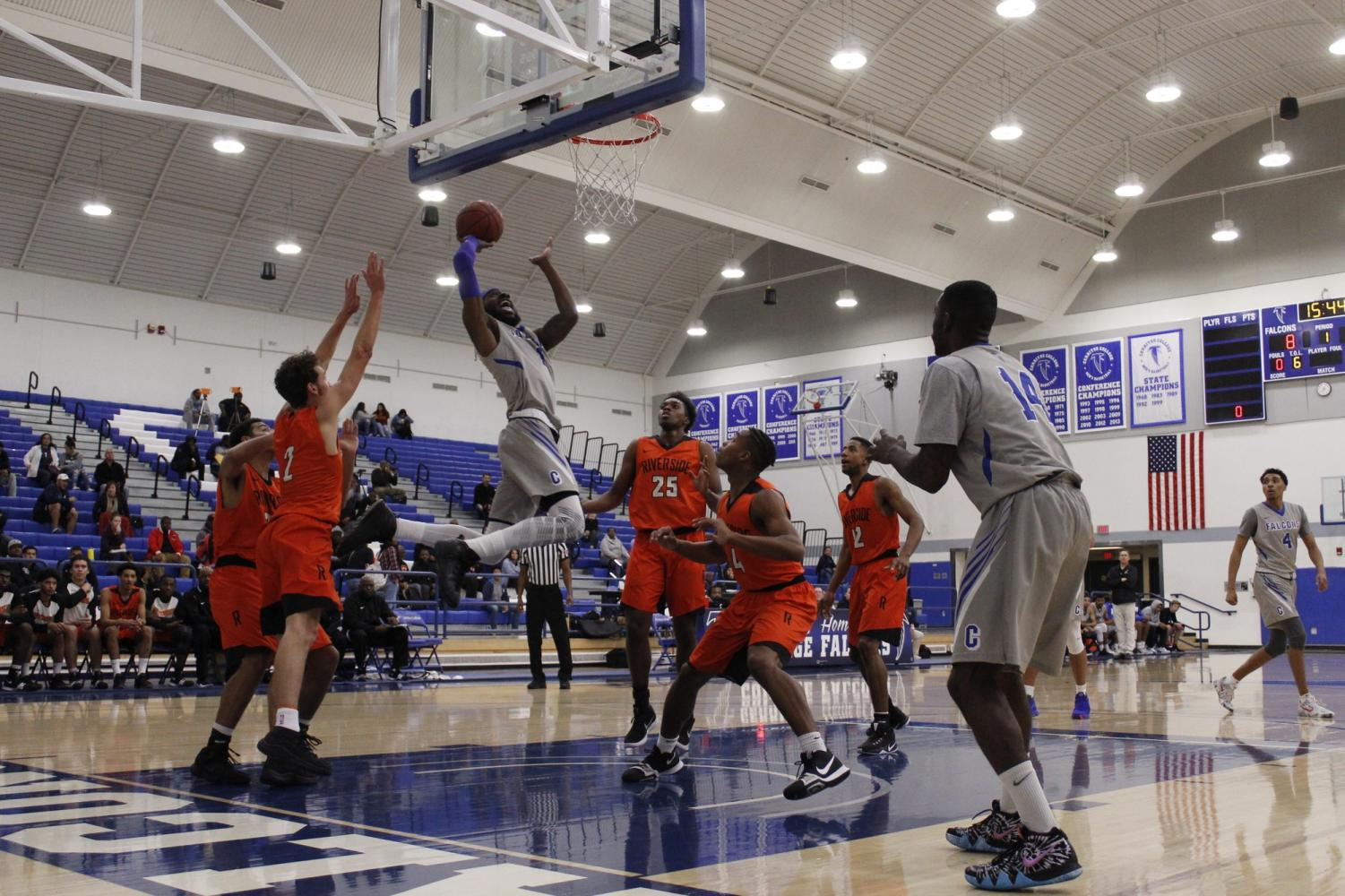 No. 1 Demetrius Thomas, the reigning South Coast Conference Player of the Year, goes hard to the basket. Thomas played 54 minutes in Friday's game, as he totaled 25 points and 14 rebounds, for an MVP worthy showing.