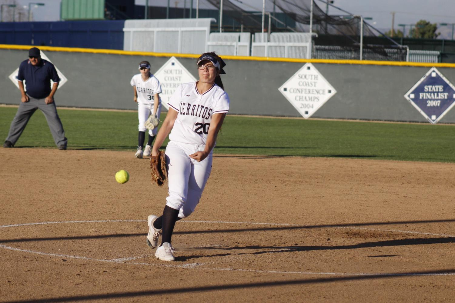 Freshman pitcher No. 20 Sierra Gerdts pitches the ball. She pitched for the remaining four innings and struck out two players.
