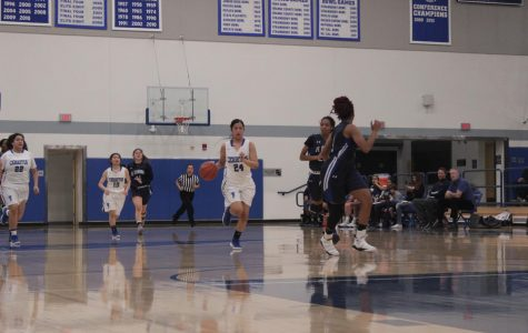 No. 24 Serena Rendon dribbles the ball up court in a game against El Camino on Feb. 2. Serena lead the team with 25 points in the game against Palomar College.