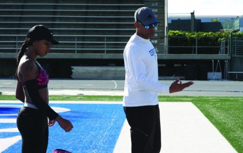 Track team member Juanita Webster and track and field coach Christopher Richardson train for upcoming track meets. Richardson, also a faculty senate member, works to have resources specific for student athletes reinstated.