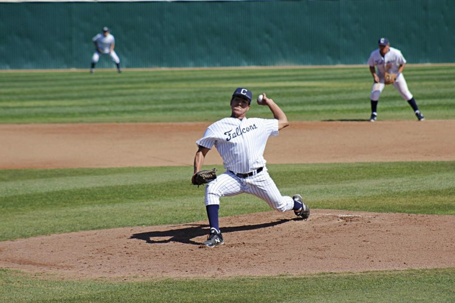 Sophomore Gilbert Romero pitching a fast ball down toward the El Camino College batter. Romero pitched only three hits, but didn't allow a single run in.