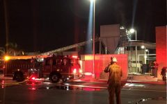 Hopper catches fire outside of woodworking building