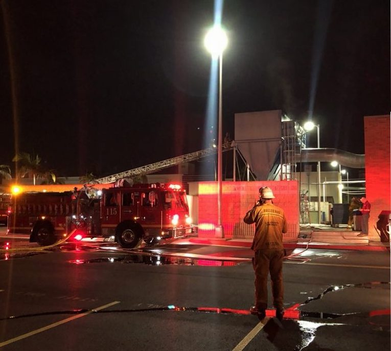 The woodworking building caught fire Tuesday night at around 8 p.m.. Norwalk's fire department put the fire out soon after arriving Photo credit: Jose Flores