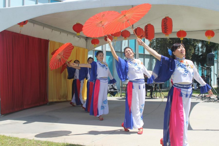 Performers+demonstrate+a+traditional+rain+dance+at+the+Falcon+Amphitheatre.+Students+were+able+to+learn+more+about+other+traditions+at+Festival+of+Asian+Cultures.+
