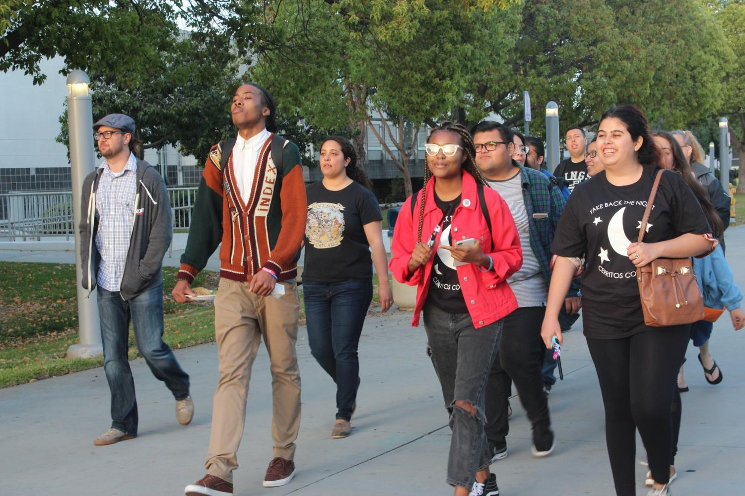 Cerritos College students and professors march around campus for Take Back the Night 2018.