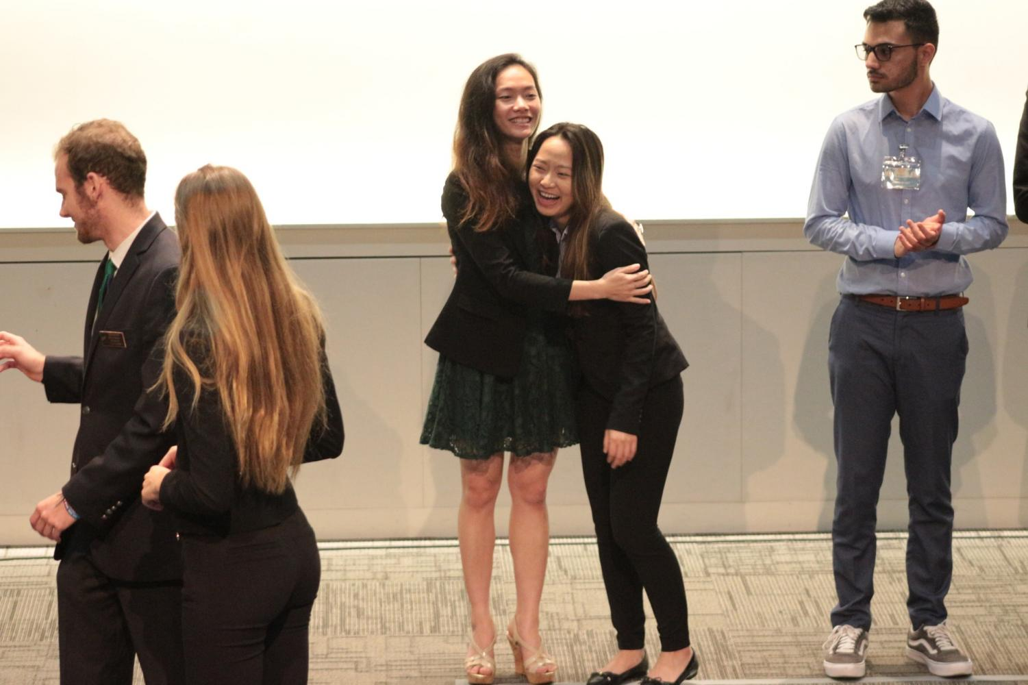 Kimberly Hong, director of programs, hugs Kelly Seang, accounting major, when her name was announced for first place in accounting principles. Phi Beta Lambda represented Cerritos College at the 2018 State Business Leadership Conference on April 6-8.