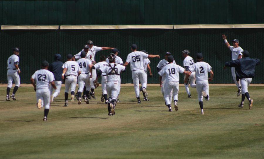 The Falcons baseball team celebrating their 14-0 shutout against the Long Beach City College Vikings.