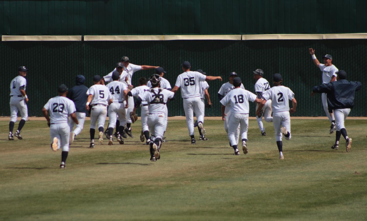 The Falcons baseball team celebrating their 14-0 shutout against the Long Beach City College Vikings.