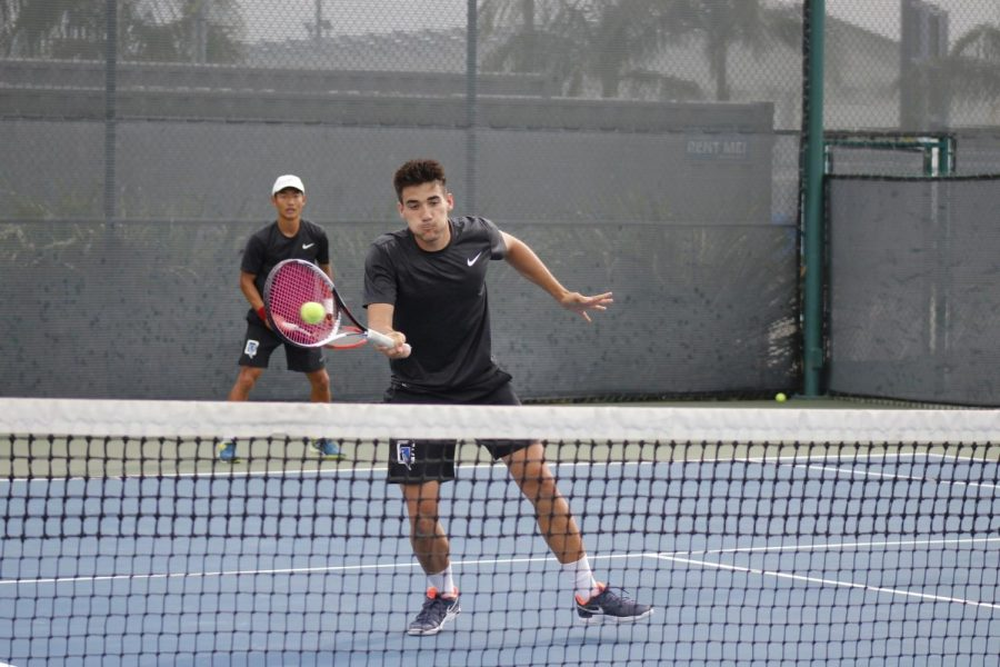 Freshman Dario Rico and his doubles partner sophomore Kwangeun Lee during their doubles match in which was won 8-6. Rico and Lee capped off the 3-0 lead going into the singles'.