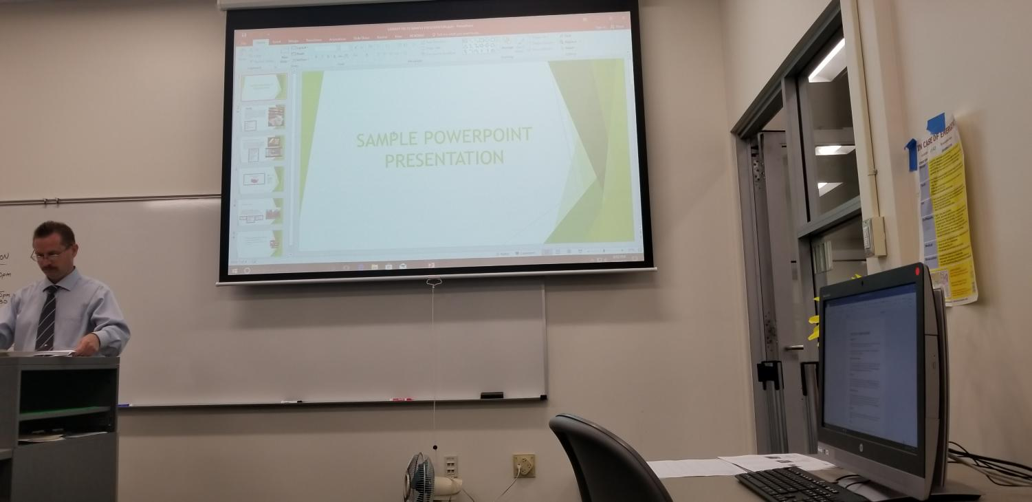 Albert Wilmovsky, an intructional lab technician shows students the basics of using PowerPoint. The workshop focuses on giving students the tools necessary to provide the best presentations they can give.
