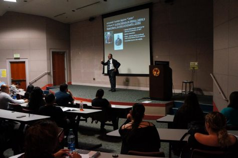 Walter Fernandez, history professor, talks about the origins of Cinco de Mayo. The presentation was on May 3.