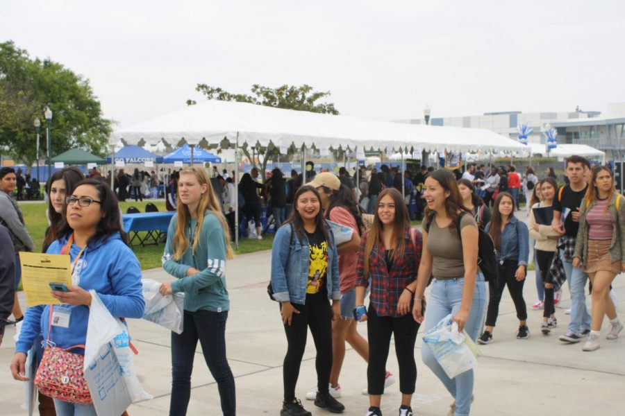 High school students from surrounding districts walk along Falcon Square to see club booths. Senior Preview Day was held on April 27.