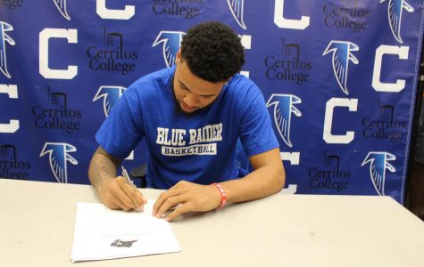 Falcons' men's basketball player Jason Carter inks with Lindsey Wilson University. His offer includes a two-year scholarship to play ball and an additional year to obtain his masters degree. Photo credit: Malik Smith