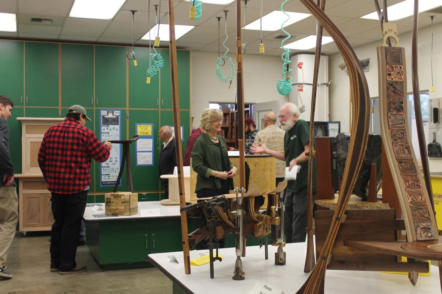 Attendees are able to view students woodwork projects. Showcased projects were created by students throughout the semester. Photo credit: Karina Quiran-Juarez