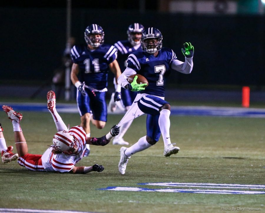 No. 7 D.J. Reed runs the ball down the field in a Cerritos College football game. Reed was drafted to the San Francisco 49ers in the 2018 NFL Draft. Photo credit: Courtesy of Daryl Peterson